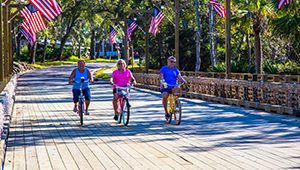 Older Adults on Bikes in Coastal Town Where You Can Afford to Retire